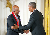 United States President Barack Obama presents the 2015 National Humanities Medal to Abraham Verghese, Physician, Professor, & Author of Menlo Park, California, during a ceremony in the East Room of the White House in Washington, DC on Thursday, September 22, 2016.<br /> Credit: Ron Sachs / CNP