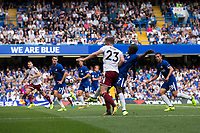 Burnley's Stephen Ward holds off the challenge from Chelsea's Ngolo Kante before going on to score his sides second goal<br /> <br /> Photographer Craig Mercer/CameraSport<br /> <br /> The Premier League - Chelsea v Burnley - Saturday August 12th 2017 - Stamford Bridge - London<br /> <br /> World Copyright &copy; 2017 CameraSport. All rights reserved. 43 Linden Ave. Countesthorpe. Leicester. England. LE8 5PG - Tel: +44 (0) 116 277 4147 - admin@camerasport.com - www.camerasport.com