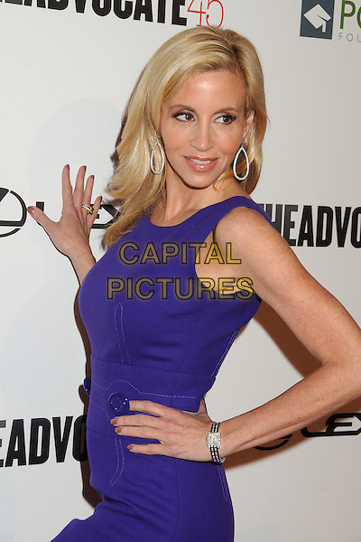 Camille Grammer.The Advocate 45th Benefiting The Point Foundation held at the Beverly Hilton Hotel, Beverly Hills, California, USA..March 29th, 2012.half length hand on hip side silver earrings purple sleeveless .CAP/ADM/BP.©Byron Purvis/AdMedia/Capital Pictures.