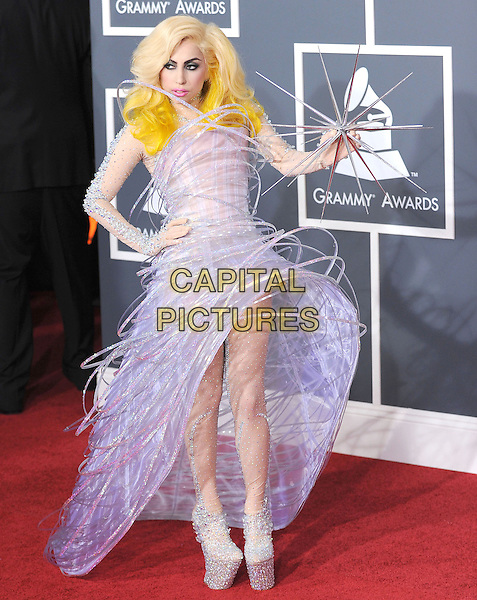 LADY GAGA (Stefani Joanne Angelina Germanotta).Arrivals at the 52nd Annual GRAMMY Awards held at The Staples Center in Los Angeles, California, USA..January 31st, 2010.grammys full length purple dress wire platform silver beads beaded dress shoes sparkly spike hand on hip.CAP/RKE/DVS.©DVS/RockinExposures/Capital Pictures