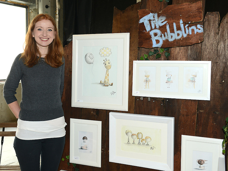 Rachael Darby with some of her atrwork at the Old Schoolhouse market on Laurence street. Photo:Colin Bell/pressphotos.ie