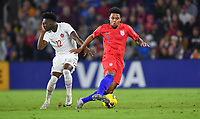 ORLANDO, FL - NOVEMBER 15: Weston McKennie #8 of the United States moves with the ball past Alphonso Davies #12 of Canada during a game between Canada and USMNT at Exploria Stadium on November 15, 2019 in Orlando, Florida.