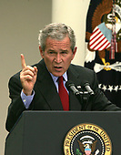 Washington, D.C. - June 14, 2006 -- United States President George W. Bush answers a reporter's question at a press conference in the Rose Garden of the White House on June 14, 2006. <br /> Credit: Dennis Brack - Pool via CNP