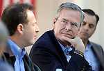 Republican presidential hopeful Jeb Bush listens to former Nevada Lt. Gov. Brian Krolicki during a roundtable discussion with ranchers and elected officials at Rancho San Rafael Park in Reno, Nev., on Wednesday, Oct. 21, 2015. (Cathleen Allison/Las Vegas Review-Journal)
