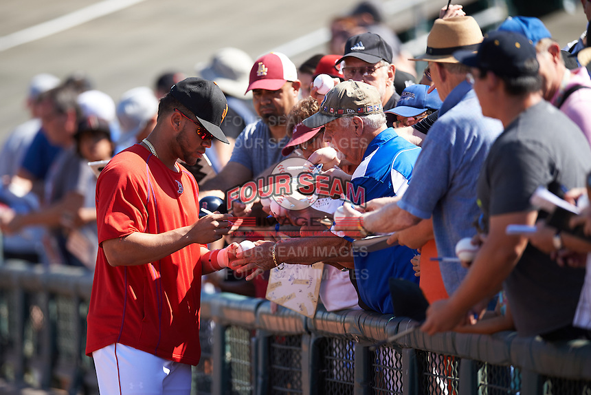 Surprise Saguaros Yoan Moncada (10), of the Boston Red Sox organization, signs autographs before a game against the Glendale Desert Dogs on October 22, 2016 at Surprise Stadium in Surprise, Arizona.  Surprise defeated Glendale 10-8.  (Mike Janes/Four Seam Images)