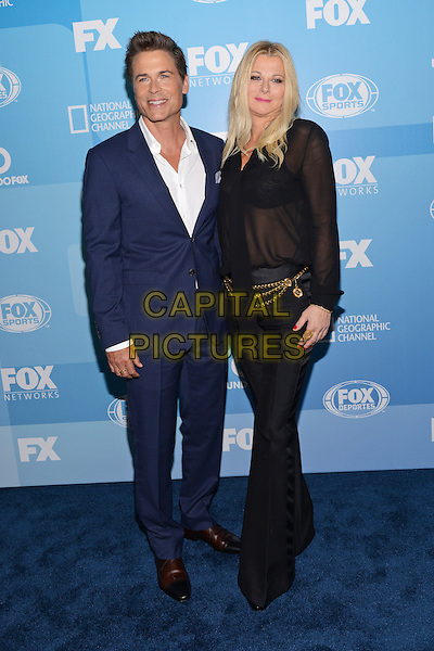 NEW YORK - MAY 11: Actor Rob Lowe (L) and Sheryl Berkoff arrive at the 2015 FOX Programming Presentation Post Party at the Wollman Rink in Central Park on May 11, 2015 in New York City. <br /> CAP/MPI/PGCS<br /> &copy;PGCS/MPI/Capital Pictures
