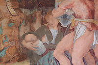 Detail of Sacrifice, showing mother nursing her baby and a wine porter, fresco by Rosso Fiorentino, 1535-37, in the Galerie Francois I, begun 1528, the first great gallery in France and the origination of the Renaissance style in France, Chateau de Fontainebleau, France. The Palace of Fontainebleau is one of the largest French royal palaces and was begun in the early 16th century for Francois I. It was listed as a UNESCO World Heritage Site in 1981. Picture by Manuel Cohen