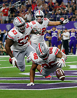 Ohio State Buckeyes defensive tackle Dre'Mont Jones (86) and defensive tackle Davon Hamilton (53) fall on a fumble in the endzone by TCU Horned Frogs quarterback Shawn Robinson (3) for a defensive touchdown during the first quarter of the NCAA football game at AT&T Stadium in Arlington, Texas on Sept. 15, 2018. [Adam Cairns / Dispatch]