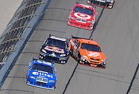 Sept. 28, 2008; Kansas City, KS, USA; Nascar Sprint Cup Series driver Tony Stewart (20) loses control after contact with Brian Vickers (83) during the Camping World RV 400 at Kansas Speedway. Mandatory Credit: Mark J. Rebilas-