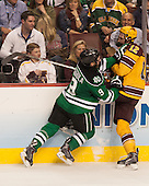 Drake Caggiula (North Dakota - 9), Justin Holl (MN - 12) - The University of Minnesota Golden Gophers defeated the University of North Dakota 2-1 on Thursday, April 10, 2014, at the Wells Fargo Center in Philadelphia to advance to the Frozen Four final.