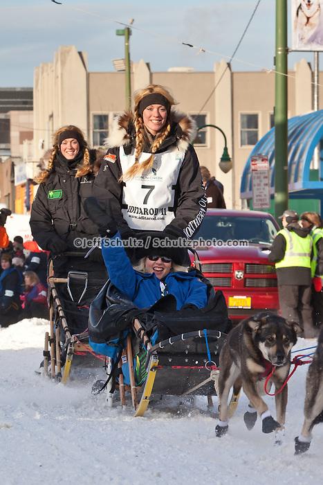 Musher Kristy Berington and Iditarider Sherry Lesar.leave the 2011 Iditarod ceremonial start line in downtown Anchorage, Alaska