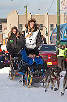 Musher Kristy Berington and Iditarider Sherry Lesar.leave the 2011 Iditarod ceremonial start line in downtown Anchorage, Alaska