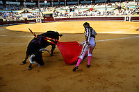 A Spanish bullfighter (matador) performs at the bullring in Torremolinos, Spain, 28 July 2006.