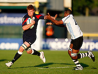 Photo: Richard Lane/Richard Lane Photography.England U20 v Fiji U20. IRB U20 World Championships. 05/06/2008. England's Hugo Ellis breaks from Fiji's Waqabaca Kotobalavu.