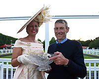 Connections of Standing Rock receive their trophy for winning The British Stallion Studs EBF 'Ladies' Evening' Fillies' Handicap, from Best Dressed Lady Deborah Grogan  during Ladies Evening Racing at Salisbury Racecourse on 15th July 2017