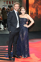 Elizabeth Olsen and fiancé Boyd Holbrook arriving for the European premiere of Godzilla, at Odeon Leicester Square, London. 11/05/2014 Picture by: Alexandra Glen / Featureflash