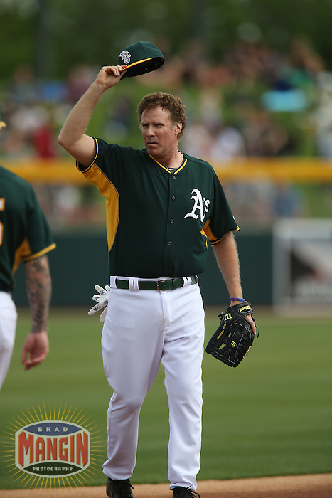 MESA, AZ - MARCH 12:  Actor Will Ferrell of the Oakland Athletics plays shortstop against the Seattle Mariners during a spring training game at HoHoKam Stadium on March 12, 2015 in Mesa, Arizona. (Photo by Brad Mangin)