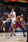 Miles Overton (20) of the Wake Forest Demon Deacons is fouled as he drives to the basket past Cahrles Buggs (23) of the Minnesota Golden Gophers during first half action at the LJVM Coliseum on December 2, 2014 in Winston-Salem, North Carolina.  (Brian Westerholt/Sports On Film)