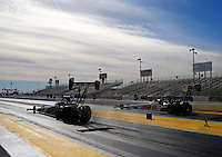 Feb 4, 2016; Chandler, AZ, USA; NHRA top fuel driver Steve Torrence (left) races alongside Richie Crampton during pre season testing at Wild Horse Pass Motorsports Park. Mandatory Credit: Mark J. Rebilas-USA TODAY Sports