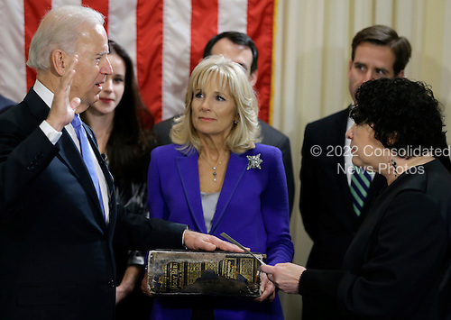 United States Vice President Joe Biden, with his wife Jill Biden, center, holding the Biden Family Bible, takes the oath of office from Supreme Court Justice Sonia Sotomayor during an official ceremony at the Naval Observatory, Sunday, Jan. 20, 2013, in Washington. .Credit: Carolyn Kaster / Pool via CNP
