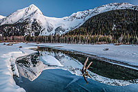 Spring landscape view of ice and open creek with snow-covered Chugach Mountains & Explorer glacier reflection in Portage Valley  April 2017<br /> <br /> Photo by Jeff Schultz/SchultzPhoto.com  (C) 2017  ALL RIGHTS RESERVED