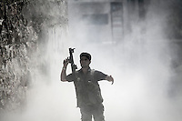 Opposition fighter fires an RPG against a tank as Free Army rebels repel an offensive attack by Assad's army during a battle in the neighborhood of Jaser Al Nerab. Intensive combats have taken place in the area under control of the rebels close to the airport to regain the position lost by the Assad's troops.