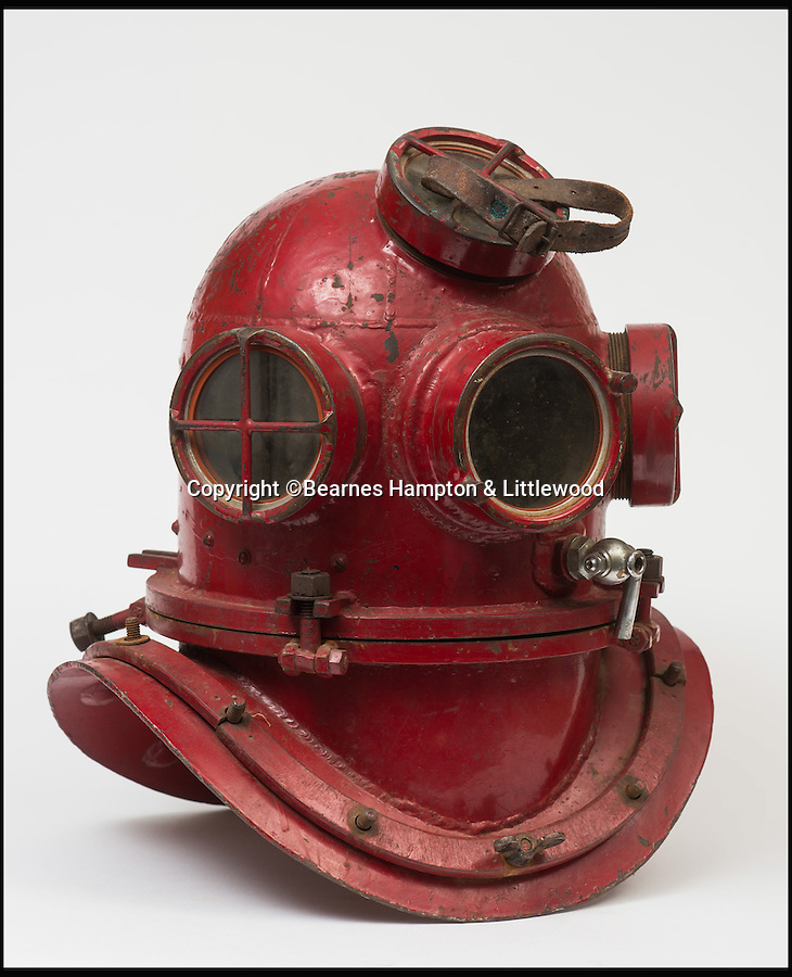 BNPS.co.uk (01202 558833)<br /> Pic: BHandI/BNPS<br /> <br /> A homemade diving helmet made by a farmer so he could locate his tractor which fell through ice.<br /> <br /> A British couple's lifetime hobby of deep sea diving is set to make them a breathtaking £500,000 when they sell one of the world's finest collection of vintage diving helmets.<br /> <br /> Anthony and Yvonne Pardoe amassed over 150 heavyweight copper helmets worn by divers during the early days of underwater excavation.<br /> <br /> Weighing about 55lbs, the dome-shaped helmets bolted onto a copper collar of a diving suit and had a hose attached to the rear to provide air supply from the surface.<br /> <br /> They are being sold in Devon next month.