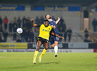 3rd December 2019; Pirelli Stadium, Burton Upon Trent, Staffordshire, England; English League One Football, Burton Albion versus Southend United; Stephen McLaughlin of Southend United jumps in the air and heads the ball on as Lucas Akins of Burton Albion comes in to head the ball - Strictly Editorial Use Only. No use with unauthorized audio, video, data, fixture lists, club/league logos or 'live' services. Online in-match use limited to 120 images, no video emulation. No use in betting, games or single club/league/player publications