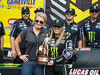 Mar 20, 2016; Gainesville, FL, USA; NHRA top fuel driver Brittany Force celebrates with Monster energy drink representative after winning the Gatornationals at Auto Plus Raceway at Gainesville. Mandatory Credit: Mark J. Rebilas-USA TODAY Sports