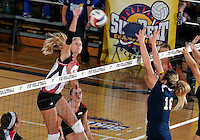 WKU middle hitter/outside hitter Lindsay Williams (10) plays against Florida International in the semi-finals of the Sunbelt Conference Volleyball Tournament.  Western Kentucky won the match 3-0 on November 18, 2011 at Miami, Florida. .