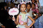 Child models walk runway in outfits from the Sugar Lulu collection, during the KidFash Magazine runway show in Brooklyn, New York on Nov 4, 2017.