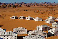 The monochromatic tents of the Akakus Magic Lodge stand out against the colours of the desert