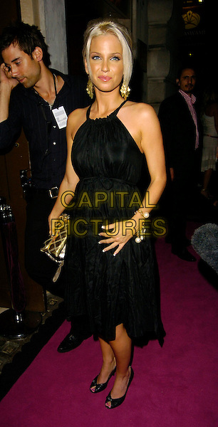 SARAH HARDING.The Pout Cosmetic Range 5th Birthday Party, Cuckoo Club, London, UK..July 18th, 2006.Ref: CAN.full length black dress halterneck gold purse .www.capitalpictures.com.sales@capitalpictures.com.©Can Nguyen/Capital Pictures