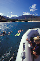 Family snorkeling, boy in foreground, off Makua Beach, west side of Oahu