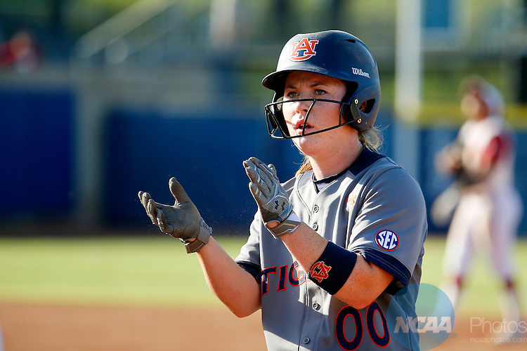 08 JUNE 2016:  Auburn catcher Carlee Wallace (0) claps as she walks back to first base during the Division I Women's Softball Championship is held at ASA Hall of Fame Stadium in Oklahoma City, OK.  Shane Bevel/NCAA Photos