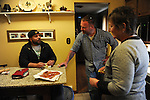 Mike Padgett, 30, cousin Garrick Leitelt, 38, and Mike's aunt, Marianne Padgett, making bacon pizza for dinner at home in Chicago Ridge, Illinois on April 21, 2015.  All three live under the same roof along with Mike's dad Wayne; Padgett is a student at the University of Illinois Chicago doing an externship in the neuroscience imaging and microscopy lab and bar tends at the Drum and Monkey on campus for extra cash.