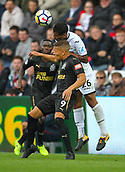 10th September 2017, Liberty Stadium, Swansea, Wales; EPL Premier League football, Swansea versus Newcastle United; Dwight Gayle of Newcastle United and Kyle Naughton of Swansea City challenge for the ball during the match