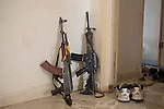 28/09/2014. Al-Yarubiyah, Syria. A Chinese made Kalashnikov and American M4 rifle lean against a wall in a building occupied by Syrian Kurdish YPG fighters in Al-Yarubiyah, Syria.<br /> <br /> Facing each other across the Iraq-Syria border, the towns of Al-Yarubiyah, Syria, and Rabia, Iraq, were taken by Islamic State insurgents in August 2014. Since then The town of Al-Yarubiyah and parts of Rabia have been re-taken by fighters from the Syrian Kurdish YPG. At present the situation in the towns is static, but with large exchanges of sniper and heavy machine gun fire as well as mortars and rocket propelled grenades, recently occasional close quarter fighting has taken place as either side tests the defences of the other.