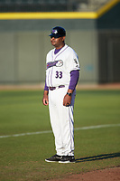 Winston-Salem Dash hitting coach Jaime Dismuke (33) coaches first base during the game against the Carolina Mudcats at BB&T Ballpark on June 1, 2019 in Winston-Salem, North Carolina. The Mudcats defeated the Dash 6-3 in game one of a double header. (Brian Westerholt/Four Seam Images)