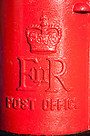 Close up of traditional red Royal Mail, Post Office pillar box from Queen Elizabeth the second, UK
