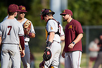 Minnesota Golden Gophers pitching coach Ty McDevitt walks to the mound for a meeting during a game against the Boston College Eagles on February 23, 2018 at North Charlotte Regional Park in Port Charlotte, Florida.  Minnesota defeated Boston College 14-1.  (Mike Janes/Four Seam Images)
