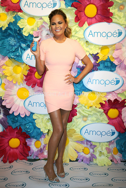 WWW.ACEPIXS.COM<br /> March 5, 2015 New York City<br /> <br /> Chrissy Teigen attends the Amop&eacute; 'Glass-Slipper-Ready' pedicure event at Grand Central Terminal on March 5, 2015 in New York City.<br /> <br /> Please byline: Kristin Callahan/AcePictures<br /> <br /> ACEPIXS.COM<br /> <br /> Tel: (646) 769 0430<br /> e-mail: info@acepixs.com<br /> web: http://www.acepixs.com