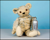 BNPS.co.uk (01202 558833)<br /> Pic: SAS/BNPS<br /> <br /> A rare German blue-tipped hot-water bottle teddy bear estimated at &pound;400.<br /> <br /> One woman's epic collection of more than 600 teddy bears is expected to fetch &pound;40,000 when it goes under the hammer.<br /> <br /> The late Yvonne Crompton amassed 635 bears, as well as teddy ornaments and pictures, over 50 years of collecting and had many limited edition models.<br /> <br /> Her vast collection filled a whole room from floor-to-ceiling at her five-bedroom family home in Wimbledon, south west London.<br /> <br /> Mrs Crompton spent decades scouring car boot sales, antique fairs and specialist exhibitions for her bears, which her husband Rufus would also often buy her as presents.