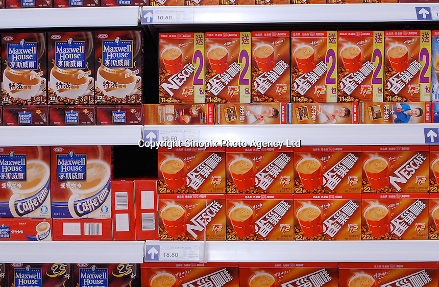 Nescafe and Maxwell Houses at the Tesco supermarket that recently opened in Beijing, China. Tesco has joined with Ting Hsin, a 25-strong, upscale hypermarket based in the Shanghai region, in a deal worth £140m last year and has started re-branding and opening the stores with the familiar Tesco logo..27 Jan 2007
