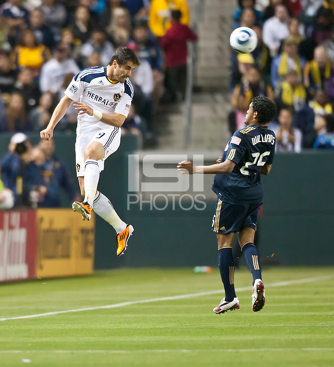 CARSON, CA – April 2, 2011: LA Galaxy forward Juan Pablo Angel (9) heads the ball past Philadelphia Union defender Sheanon Williams (25) during the match between LA Galaxy and Philadelphia Union at the Home Depot Center, March 26, 2011 in Carson, California. Final score LA Galaxy 1, Philadelphia Union 0.