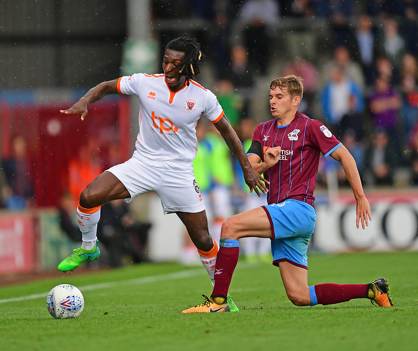 Blackpool's Sessi D'Almeida is fouled by Scunthorpe United's Conor Townsend<br /> <br /> Photographer Chris Vaughan/CameraSport<br /> <br /> The EFL Sky Bet League One - Scunthorpe United v Blackpool - Saturday 9th September 2017 - Glanford Park - Scunthorpe<br /> <br /> World Copyright &copy; 2017 CameraSport. All rights reserved. 43 Linden Ave. Countesthorpe. Leicester. England. LE8 5PG - Tel: +44 (0) 116 277 4147 - admin@camerasport.com - www.camerasport.com