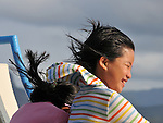 Orchid Island, Taiwan -- Kids enjoying the wind and the sun on the ferry ride from Kenting to Orchid Island.