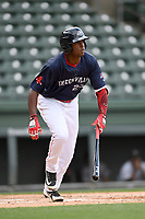 Left fielder Marino Campana (23) of the Greenville Drive bats runs out a batted ball in a game against the Augusta GreenJackets on Wednesday, April 25, 2018, at Fluor Field at the West End in Greenville, South Carolina. Augusta won, 9-2. (Tom Priddy/Four Seam Images)