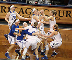 SIOUX FALLS MARCH 22:  Grand Valley State celebrates their 59-56 win over Pittsburg State University in their quarterfinal game at the NCAA Women's Division II Elite 8 Tournament at the Sanford Pentagon in Sioux Falls, S.D. (Photo by Dave Eggen/Inertia)