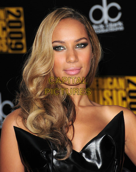 LEONA LEWIS.The 2009 American Music Awards held at The Nokia Theatre L.A. Live in Los Angeles, California, USA. .November 22nd, 2009.AMA AMA's headshot portrait eyeliner  black strapless  leather shiny pvc .CAP/RKE.©DVS/RockinExposures/Capital Pictures